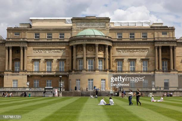 Visitors walk on the lawn in the newly opened gardens at Buckingham Palace on July 08, 2021 in London, England. The gardens will be open from...