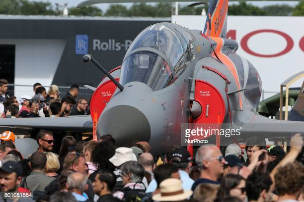 Visitors walk on the tarmac on the last day of the International Paris Air Show at Le Bourget Airport near Paris on June 25 2017 This show is the...