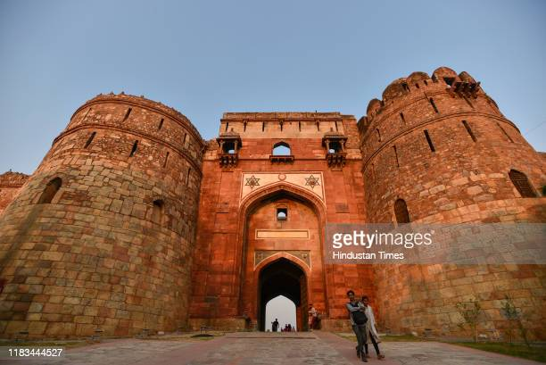 Visitors walk out during dusk at Purana Qila on November 19 2019 in New Delhi India Archaeological Survey of India is celebrating Heritage Week from...