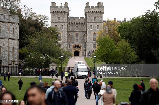 Visitors walk outide the Long Walk entrance to Windsor Castle in Windsor, west of London on May 6 after the announcement that Britain's Meghan,...