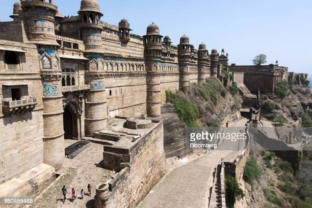 Visitors walk outside Gwalior Fort in Gwalior Madhya Pradesh India on Friday June 2 2017 India'srates traders seem convinced recordlow inflation and...