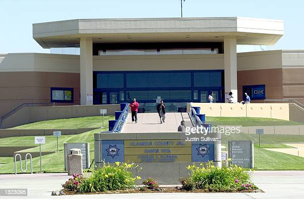 Visitors walk outside of the Alameda County Jail at San Rita June 19 2001 in Dublin California The jail is installing a $44 million solar panel...