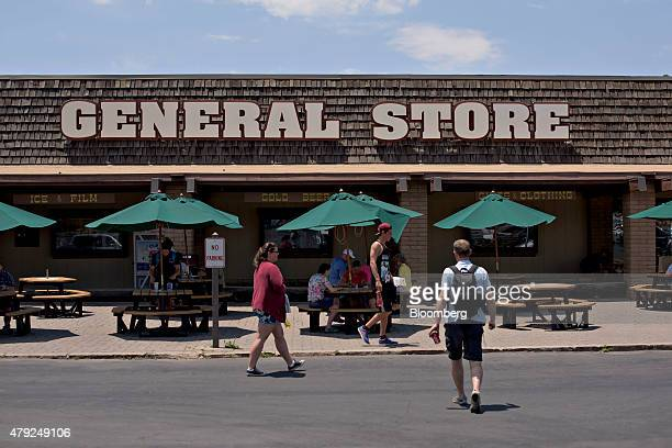 Visitors walk outside the Canyon Village Market General Store at Grand Canyon National Park in Grand Canyon Arizona US on Thursday June 25 2015 The...