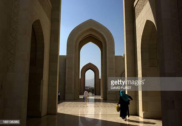 Visitors walk outside the Grand Mosque in the Omani capital Muscat on February 14 2010 AFP PHOTO/DAVID FURST