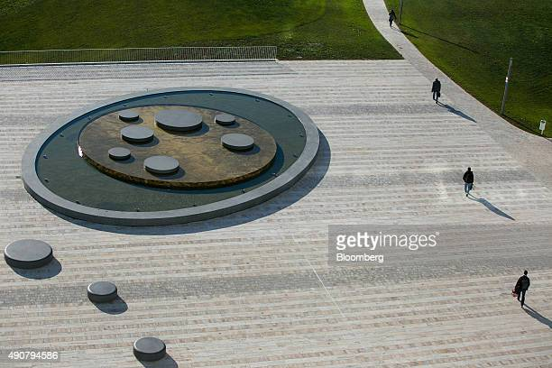 Visitors walk outside the new Robert Bosch GmbH research and development center in Renningen Germany on Wednesday Sept 30 2015 Bosch warned...