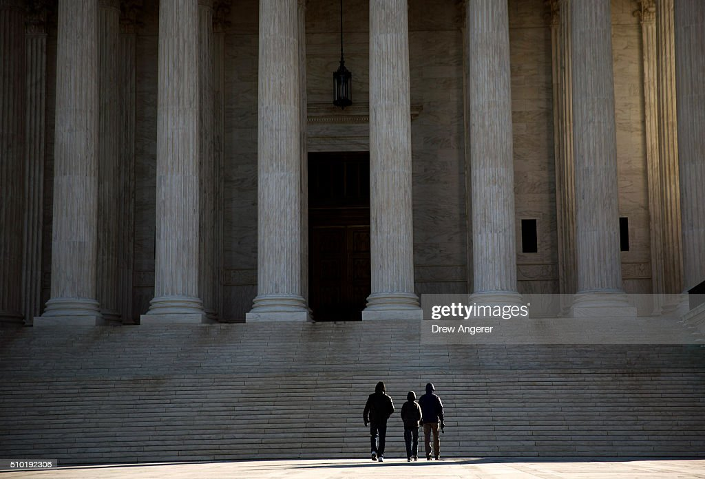 Visitors walk outside the U.S. Supreme Court following the death of Supreme Court Justice Antonin Scalia February 14, 2016 in Washington, DC. Supreme Court Justice Antonin Scalia was at a Texas Ranch Saturday morning when he died at the age of 79.