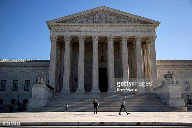 Visitors walk outside the US Supreme Court following the death of Supreme Court Justice Antonin Scalia February 14 2016 in Washington DC Supreme...
