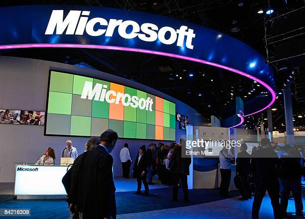 Visitors walk pass the Microsoft Corp booth at the 2009 International Consumer Electronics Show at the Las Vegas Convention Center January 8 2009 in...