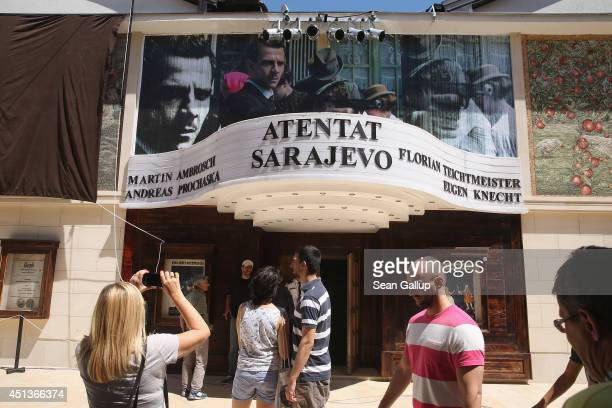 Visitors walk past a cinema that is showing a film about the assassination of Austrian Archduke Ferdinand by Serbian secessionist Gavrilo Princip in...