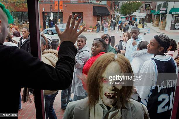Visitors walk past a display that was set up in a window October 27 2005 in Salem Massachusetts Thousands of tourists come to celebrate the large...