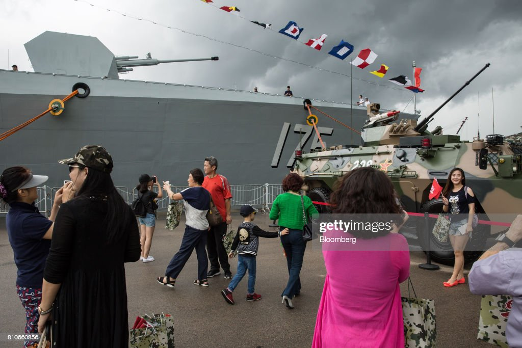 Visitors walk past a People's Liberation Army (PLA) tank during an open day at the Ngong Suen Chau Barracks in Hong Kong, China, on Saturday, July 8, 2017. China's bid to display some soft power in Hong Kong-- with a visit by the country's first aircraft carrier -- has also showcased its heavy-handed approach to security. Photographer: Billy H.C. Kwok/Bloomberg via Getty Images