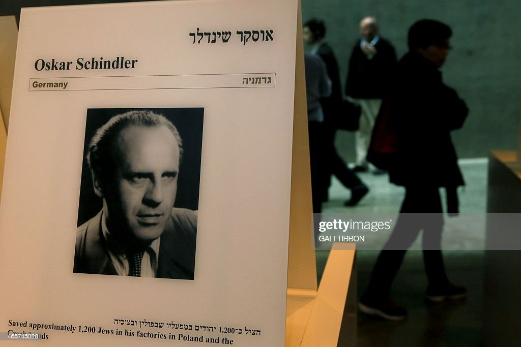 oskar schindler photos pictures of oskar schindler getty images  ors walk past a portrait of oskar schindler at the yad vashem holocaust memorial museum in