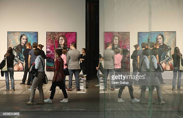 """Visitors walk past a work by Martin Eder at the """"art berlin contemporary"""" art trade fair at The Station on September 20, 2014 in Berlin, Germany. The..."""