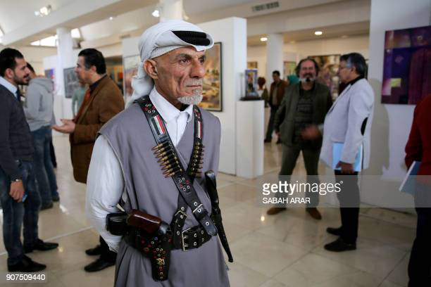 TOPSHOT Visitors walk past contemporary art pieces during the annual exhibition of the Iraqi Fine Artists Association in the capital Baghdad on...