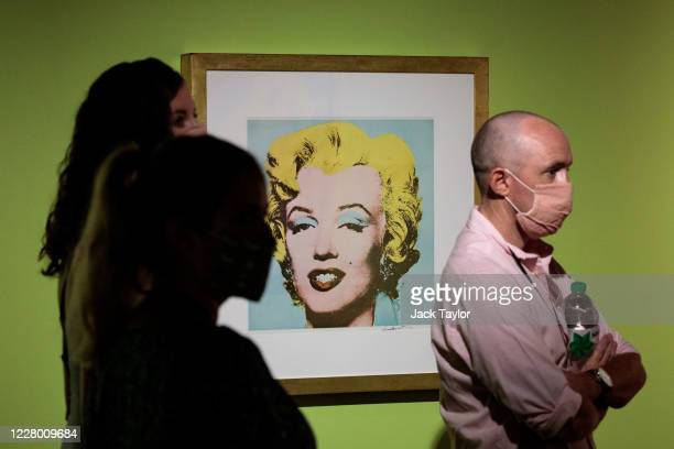 Visitors walk past 'Marilyn Monroe' by Andy Warhol at the 'Andy Warhol Pop Art' exhibition at the RCB Galleria on August 12 2020 in Bangkok Thailand...