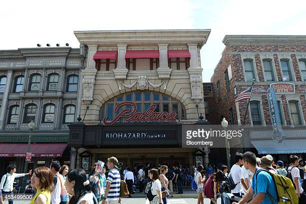 Visitors walk past the Biohazard The Real attraction at Universal Studios Japan operated by USJ Co in Osaka Japan on Thursday Aug 7 2014 USJ is...