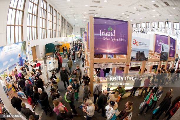 Visitors walk past the booth of Ireland at the international travel fair ITB in Berlin Germany 13 March 2016 Photo KLAUSDIETMAR GABBERT/dpa | usage...