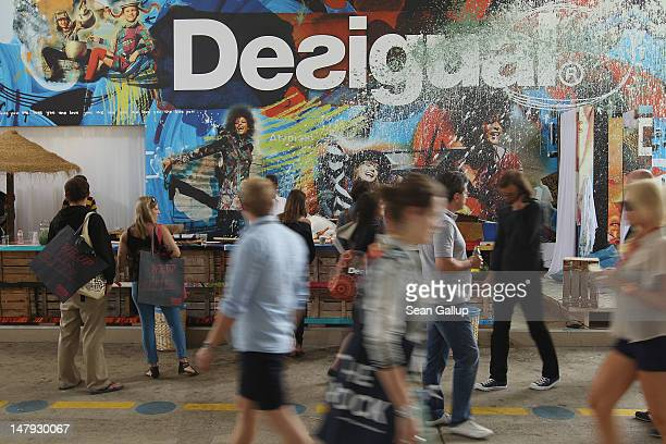 Visitors walk past the desigual stand at the 2012 Bread & Butter fashion trade fair at former Tempelhof Airport on July 6, 2012 in Berlin, Germany....