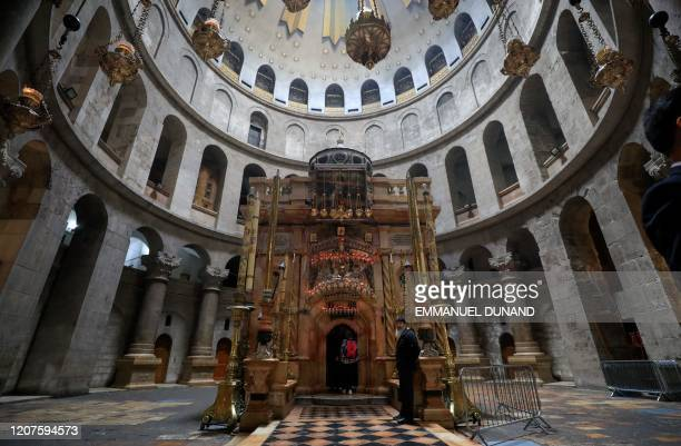 Visitors walk past the Edicule in the Church of the Holy Sepulchre traditionally believed to be the burial site of Jesus Christ in the Old City of...