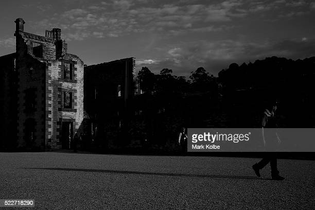 Visitors walk past the front of the Penitentiary in the Port Arthur Historical Site on April 18 2016 in Port Arthur Australia The historic town...