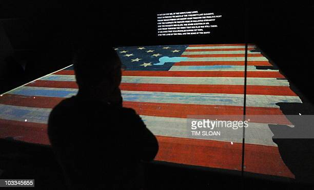 Visitors walk past the main attraction of The StarSpangled Banner Gallery the almost 200year old 30by 34foot flag that inspired Francis Scott Key to...