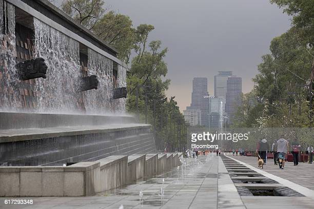 Visitors walk past the newly renovated Xochipilli fountain inside the second section of Chapultepec Park in Mexico City Mexico on Saturday Sept 24...