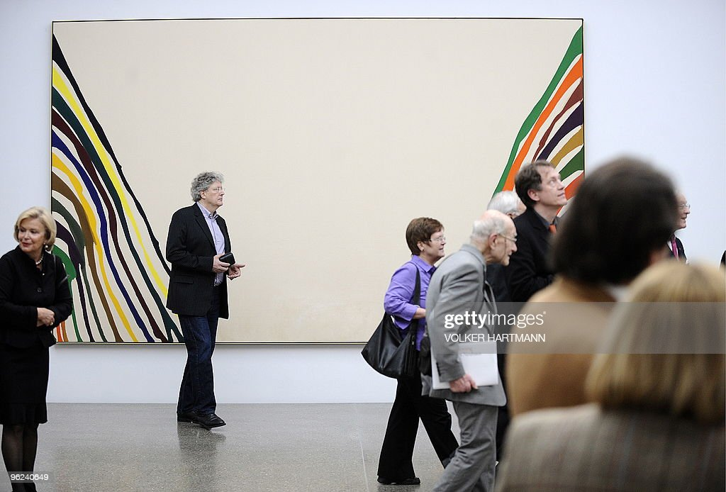 """Visitors walk past the painting """"KSI"""" (a : News Photo"""