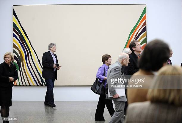 Visitors walk past the painting KSI by US artist Morris Louis in the new Folkwang Museum after its official opening on January 28 2010 in Essen...