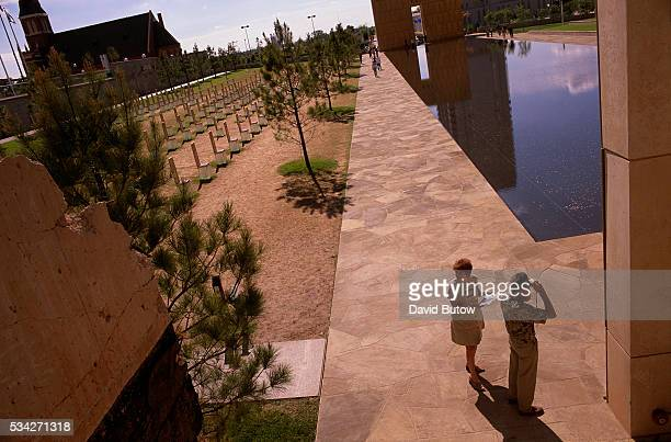 Visitors walk past the reflecting pool at the Oklahoma City National Memorial On April 19 Timothy McVeigh exploded a truck bomb outside of the Alfred...