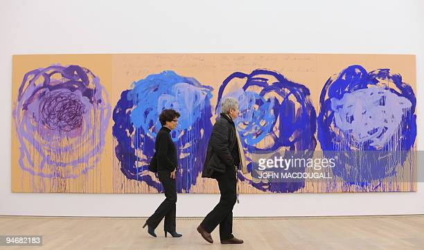 Visitors walk past US artist Cy Twombly's 'Rose' series at the Brandhorst museum in Munich December 15 2009 The Brandhorst Museum was opened on May...