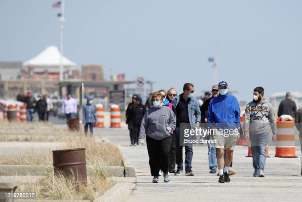 Visitors walk the boardwalk at Jones Beach on April 19 2020 in Wantagh New York Jones Beach lies on the south shore of Long Island an area which has...