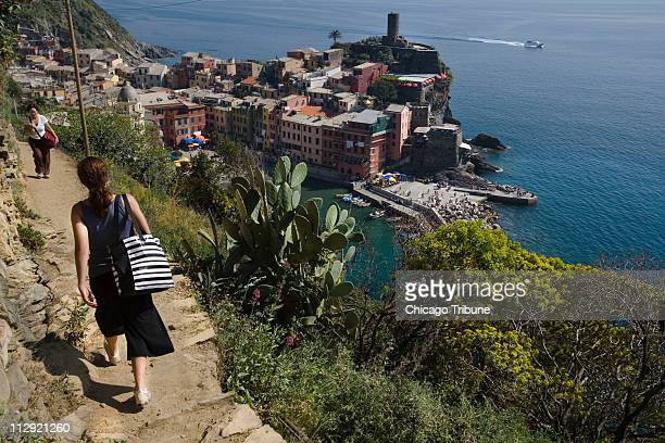 Visitors walk the path leading into Vernazza from Monterosso in the Cinque Terre region of Italy