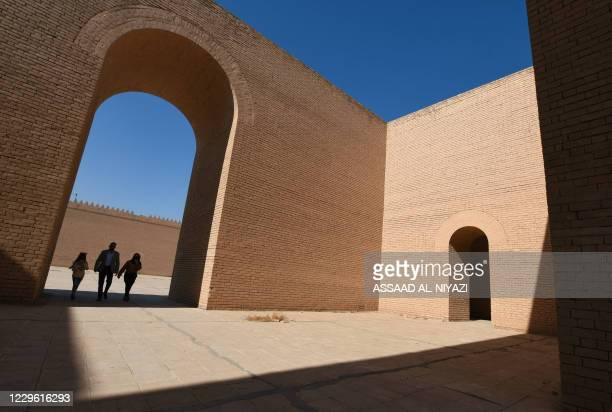 Visitors walk through an archway at the archaeological site of ancient Babylon, about 100Km south of the Iraqi capital, on November 14, 2020.