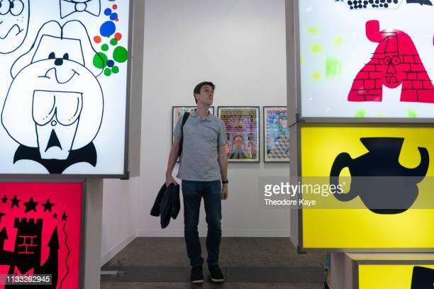 Visitors walk through an art installation at Art Basel on March 28, 2019 in Hong Kong, Hong Kong.
