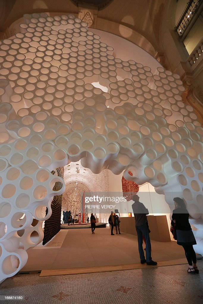 Visitors walk through an exhibition covering the work of design team Ronan & Erwan Bouroullec, formed by the two brothers from Brittany, at the Musee des Arts Decoratifs in Paris on May 16, 2013.