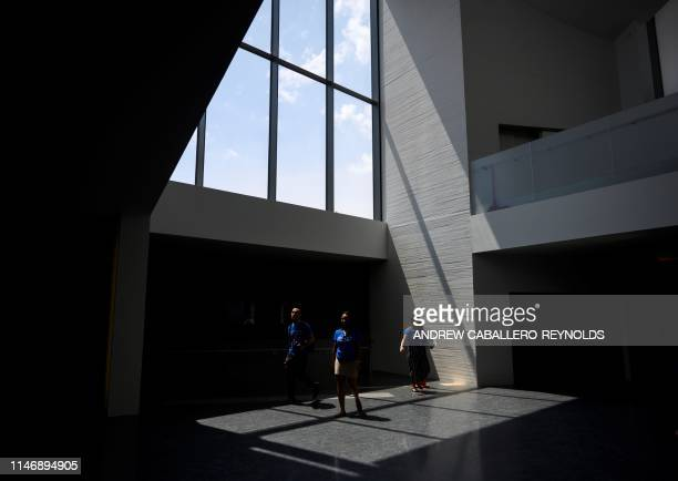 Visitors walk through building that is part of the REACH an expansion project at the Kennedy Center during a press preview in Washington DC on May 29...