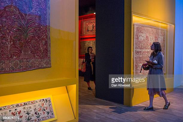 Visitors walk through exhibits during the press preview of 'The Fabric of India' exhibition at the Victoria and Albert Museum on September 30 2015 in...