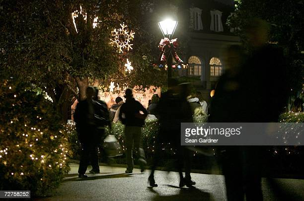 Visitors walk through Jackson square after TV personality Ellen DeGeneres lights the holiday display at Jackson Square on December 6, 2006 in New...