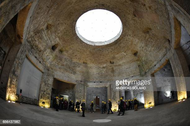 Visitors walk through one of the rooms of the Domus Aurea a large palace built by the Roman Emperor Nero in the first century during a exhibition for...