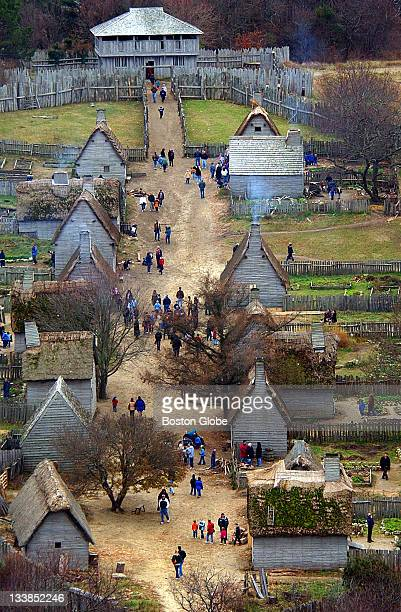 Visitors walk through Plimoth Plantation just before the holiday