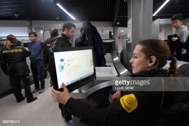 Visitors walk through security screening before accessing the Sagrada Famila Basilica in Barcelona on January 3 2018 The Sagrada Familia basilica...