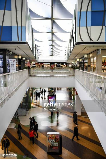 Visitors walk through shopping arcades at the Dolce Vita Tejo shopping mall operated by AXA Real Estate Investment Managers SGR SpA in Lisbon...