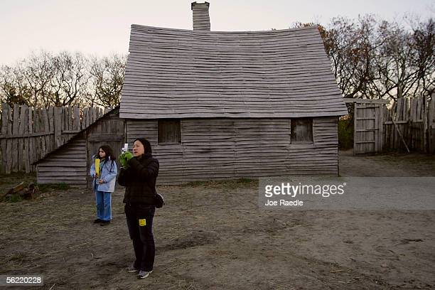 Visitors walk through the 1627 Pilgrim Village at Plimoth Plantation where roleplayers portray Pilgrims seven years after the arrival of the...