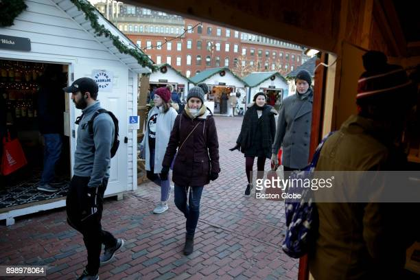 Visitors walk through the Boston Winter holiday festival at City Hall Plaza in Boston on Dec 21 2017 Winter can turn Bostons City Hall Plaza into a...