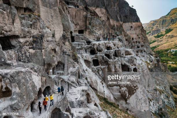 Visitors walk through the cave city of Vardzia, originally built in 12th century and now a working monastery, Georgia