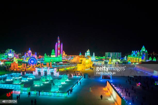 Visitors walk through the China Ice and Snow World at the 16th Harbin International Ice and Snow Festival in Harbin northeast China's Heilongjiang...