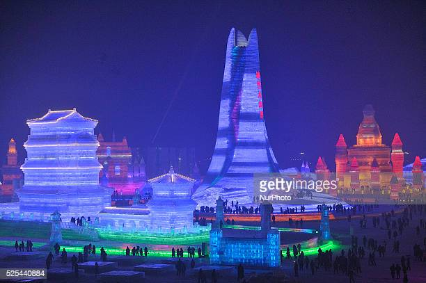 Visitors walk through the China Ice and Snow World at the 32th Harbin International Ice and Snow Festival on December 22 2015 in Harbin China The...
