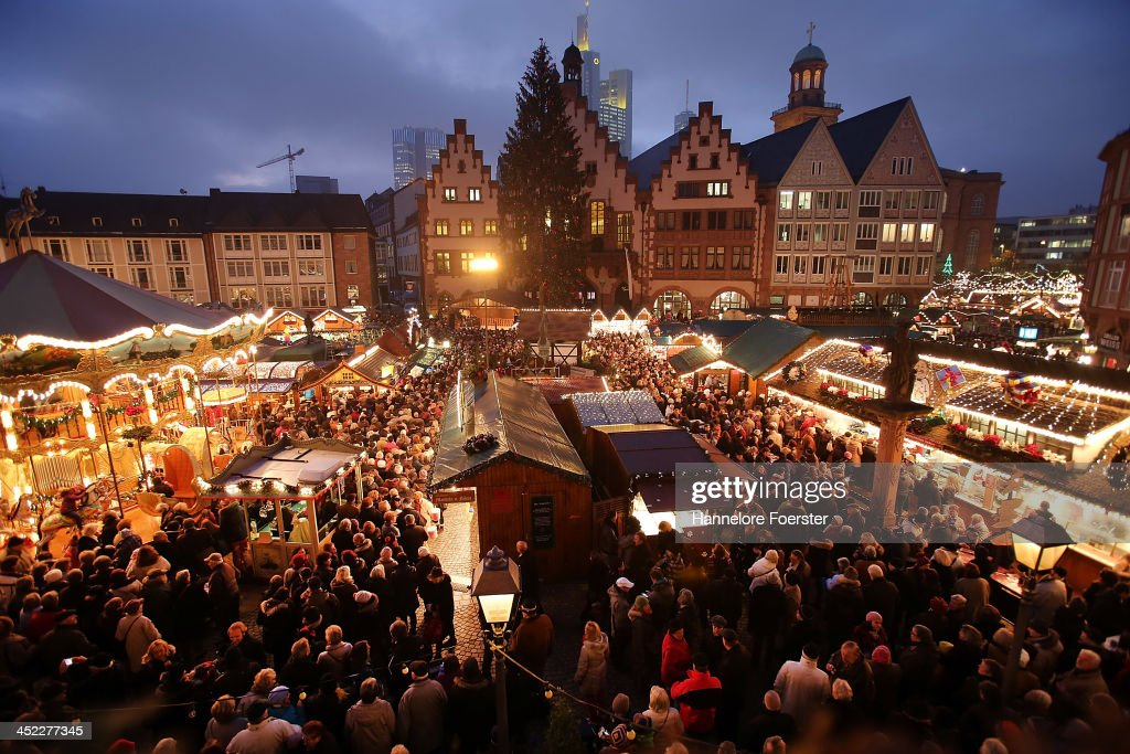 Visitors Walk Through The Christmas Market At Roemerberg Square On Its Opening Day November 27