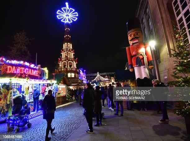 Visitors walk through the Christmas market in Berlin's Spandau district on November 26, 2018.