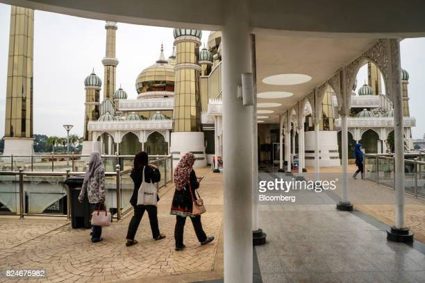 Visitors walk through the Crystal Mosque in Kuala Terengganu Terengganu Malaysia on Monday July 23 2017 With a federal election due within 12 months...